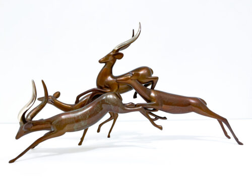 Impalas Leaping Sculpture 360 by Loet Vanderveen at Art Leaders Gallery. Group of Impalas shown in the Silver Burgundy patina. Hand crafted bronze animal sculpture.