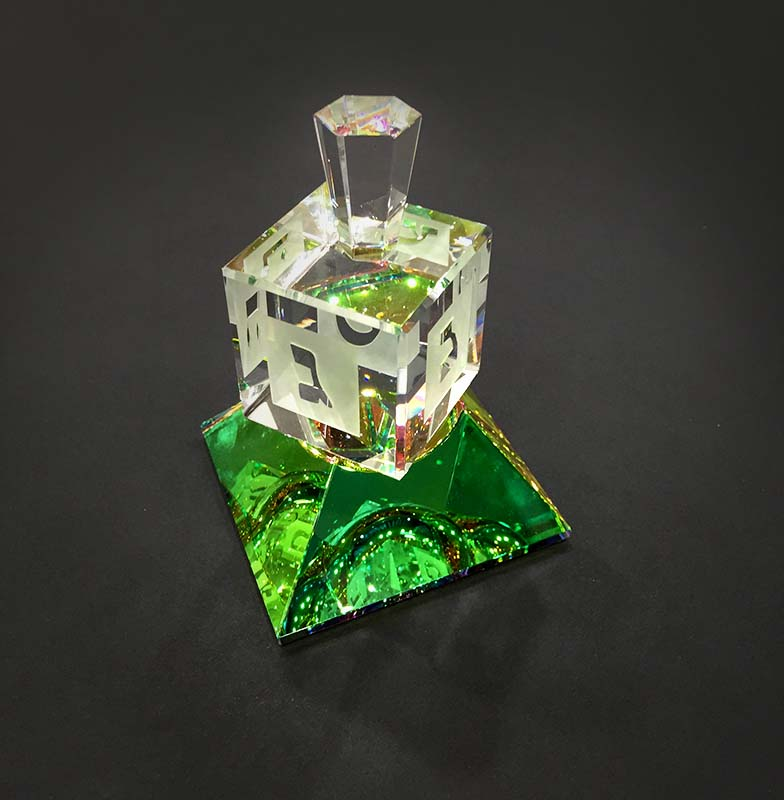 Crystal Dreidel on Base by Harold Lustig, Black Background