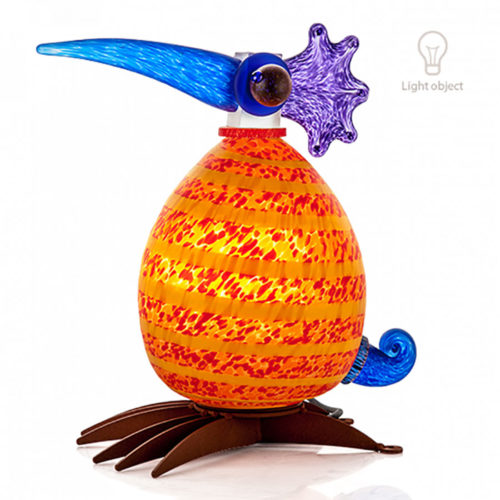 """Fat Gonzo Lamp"" in Orange by Borowski Glass Studio. Art Leaders Gallery, voted ""Michigan's Best Fine Art Gallery"" is located in the heart of West Bloomfield. This full service fine art gallery is the destination for all your art and custom picture framing needs. Our extensive inventory of art includes styles ranging from contemporary to traditional. The gallery represents international, national, and emerging new talent as well as local Michigan artists."