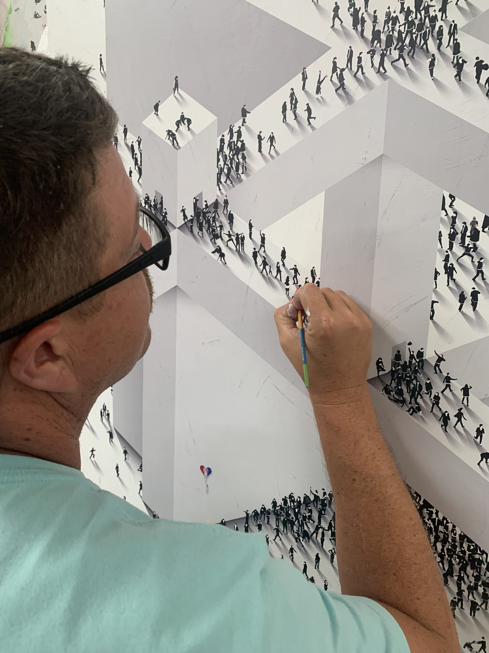 Craig Alan adding custom details to a piece of artwork from his Populus series.