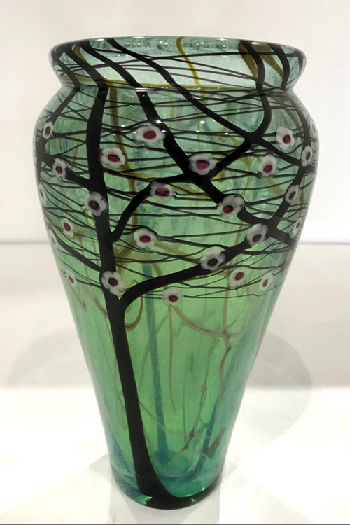 "Cherry Blossom Tree Vase by Vandermark Merritt Glass Studios at Art Leaders Gallery, voted ""Michigan's Best Fine Art Gallery"" is located in the heart of West Bloomfield. This full service fine art gallery is the destination for all your art and custom picture framing needs. Our extensive inventory of art includes styles ranging from contemporary to traditional. The gallery represents international, national and emerging new talent as well as local Michigan artists."
