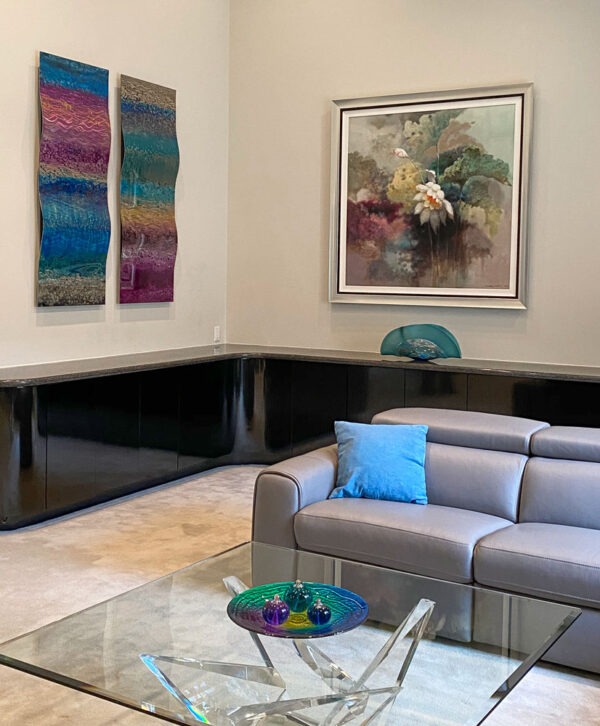 Stephan Yi framed Lotus flower on canvas and Ken Rausch bending steel wall sculptures hanging in living room. Cool colors on stainless steel.