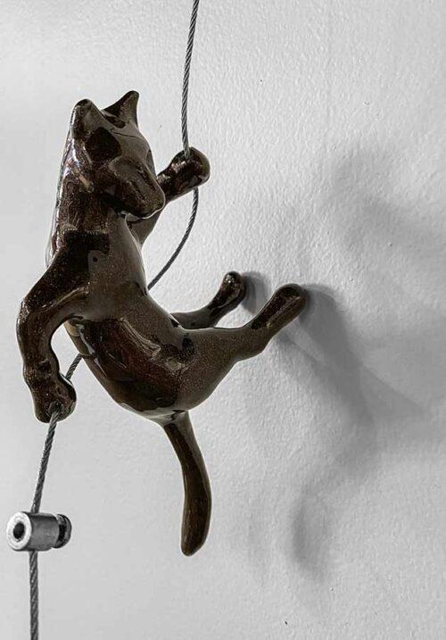 Brown Wall Climber Sculpture