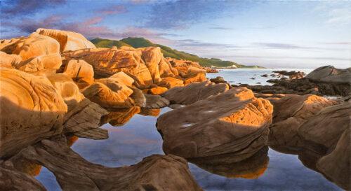 Sunset on seaside rocks