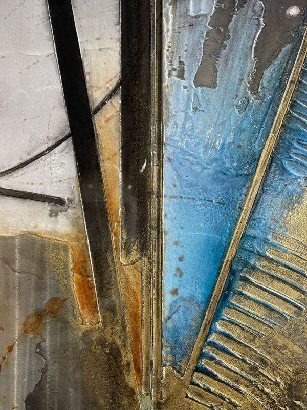 Abstract, metal, wall sculpture with blue, grey, and gold.