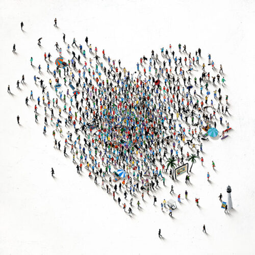 People flocking to the beach in a heart shape