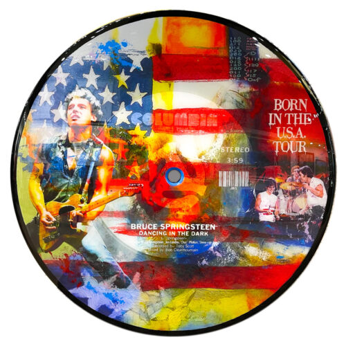 Dancing in the Dark - Bruce Springsteen by The Bisaillon Brothers. This Pop Artwork is a mixed media piece of Bruce Springsteen during the Born in the USA tour. Record shape canvas with american flag background. Bruce Springsteen Dancing in the Dark record.
